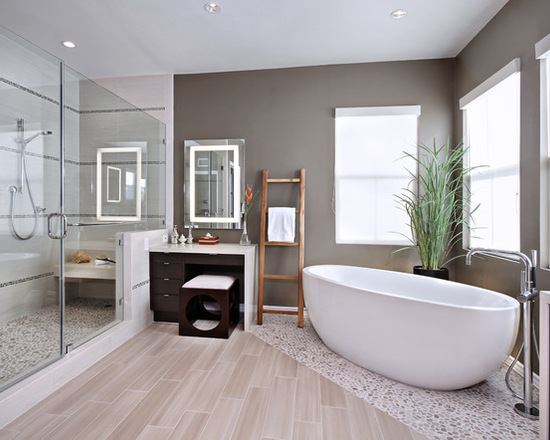 Bathroom with wooden floors and angled freestanding bath tub