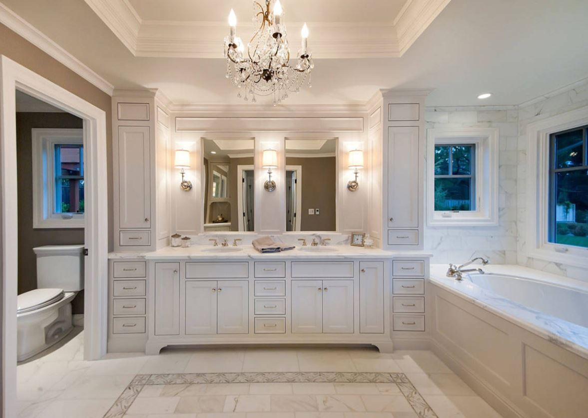 master bathroom with custom painted insert cabinets and beautiful light fixtures